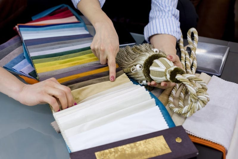 Interior designer shows samples of interior fabrics
